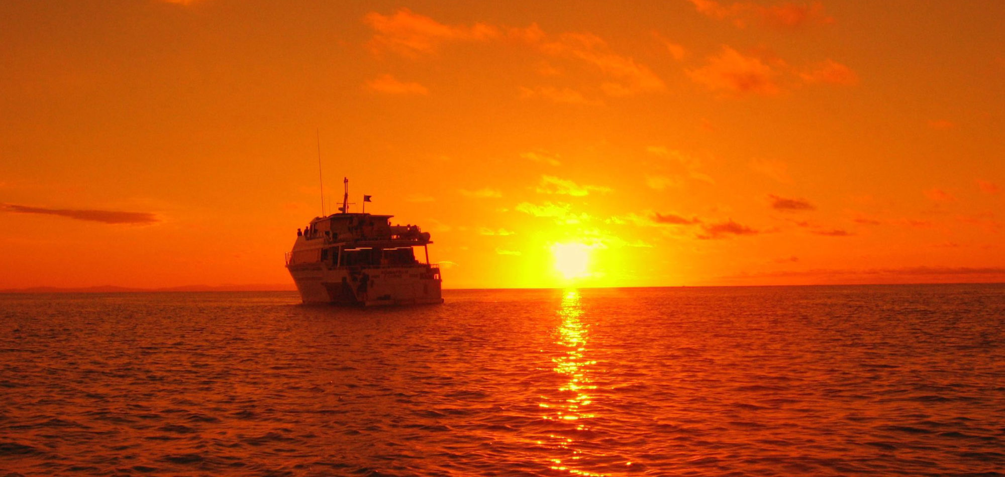 Cairns dive certification - sunset on the Great Barrier Reef
